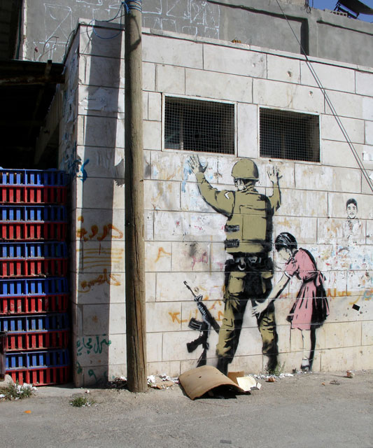 http://peoplesgeography.files.wordpress.com/2007/12/palestinian-girl-and-soldier-wall-mural.jpg
