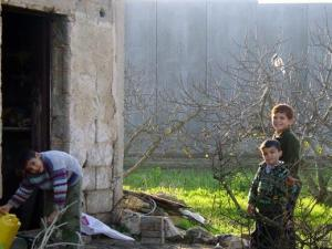 Wall running through back garden of Palestinian home. Courtesy S-C. A.